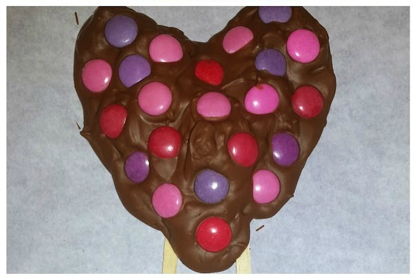 chocolate valentines day share a lollipop on a stick snymed dot com