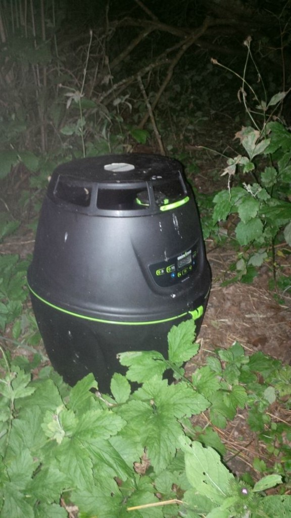 Green Strike Mosquito Preventer at night -- We can see mosquitoes going in and using the unit to lay their eggs.